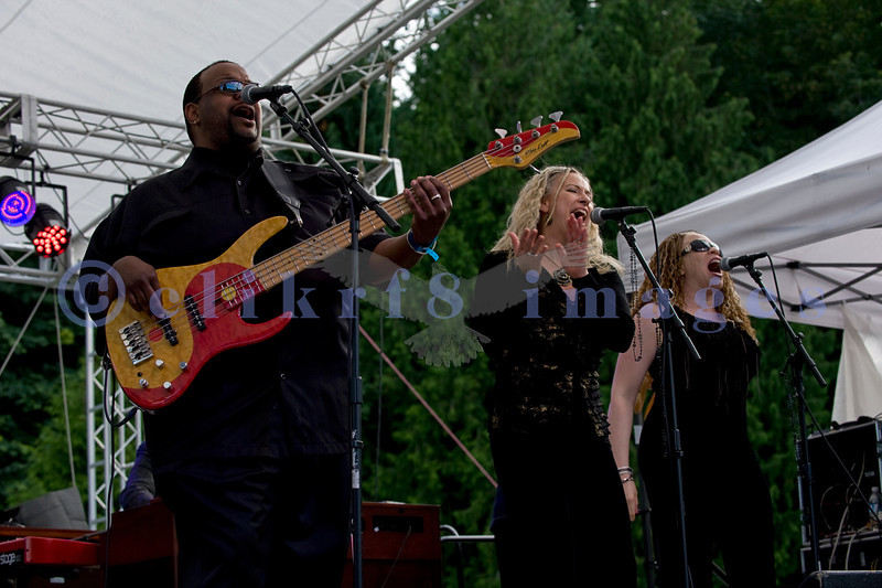 The Curtis Salgado Band, whose namesake survived cancer, performed with a full ensemble at the Mt. Baker Rhythm and Blues Festival in Deming, Washington. Margaret Linn: backing vocals; Tracy Arrington: bass; LaRhonda Steele: backing vocals