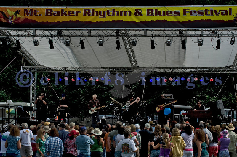 The Curtis Salgado Band, whose namesake survived cancer, performed with a full ensemble at the Mt. Baker Rhythm and Blues Festival in Deming, Washington. Curtis Salgado: vocals & harmonica; Franck Goldwaser: guitar; Dave Fleschner: keyboards; Tracy Arrington: bass; Brian Foxworth: drums; Dave Mills: trumpet; Gary Harris: saxophone; Margaret Linn: backing vocals; LaRhonda Steele: backing vocals