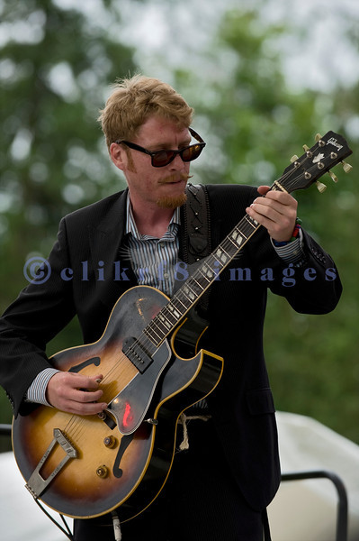 Multiple nominees of the Canada's Maple Award for individual blues musicians, The Twisters entertained the appreciative audience  on Sunday afternoon, July 31, 2011. Brandon Isaak, electric guitar and vocals