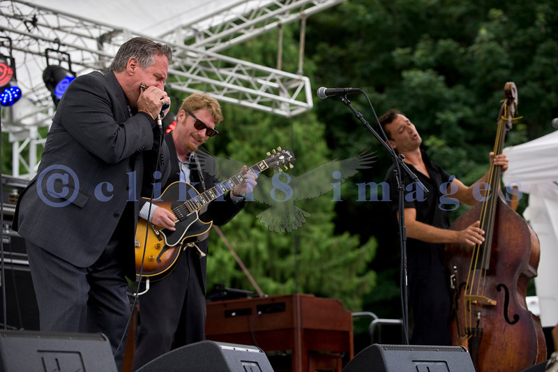 """Multiple nominees of the Canada's Maple Award for individual blues musicians, The Twisters entertained the appreciative audience  on Sunday afternoon, July 31, 2011. Dave """"Hurricane Dave"""" Hoerl, harmonica and vocals; Brandon Isaak, electric guitar and vocals; Keith Picot, stand up bass"""