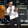 Former lead singer with Santana, Alex Ligertwood, plays the cowbell and sings with the World Classic Rockers at the Chippewa Valley Rock Festival.