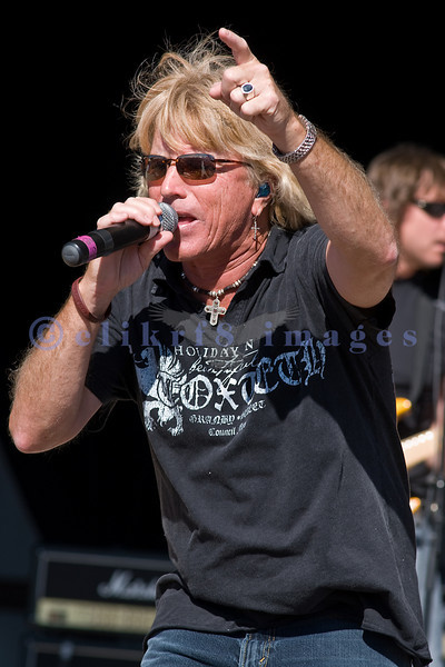 Fergie Frederiksen former lead singer with Toto sings with members of World Classic Rockers at the Chippewa Valley Rock Festival.