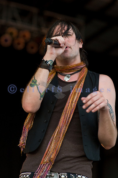 Austin Winkler, frontman of Hinder, entertains the Sunday crowd at the 2007 Chippewa Valley Rock Festival after a huge downpour.