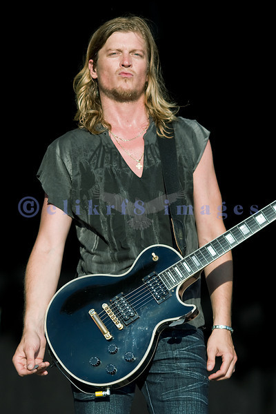 Frontman Wes Scanlin on guitar and vocals of Puddle of Mudd on stage at the Chippewa Valley Rock Festival.