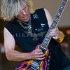 Lead guitarist C. C. DeVille of Poison plays his Flying V at the Chippewa Valley Rock Festival.