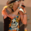 "Bret Michaels, frontman for Poison and star of ""Rock of Love"" on stage at the Chippewa Valley Rock Festival on Thursday afternoon."