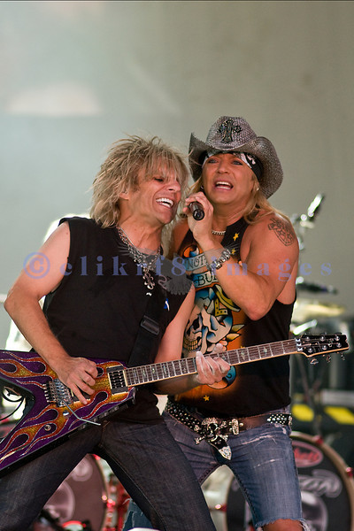 """Bret Michaels, frontman for Poison and star of """"Rock of Love"""" on stage with lead guitarist C. C. DeVille at the Chippewa Valley Rock Festival on Thursday afternoon."""
