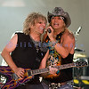 "Bret Michaels, frontman for Poison and star of ""Rock of Love"" on stage with lead guitarist C. C. DeVille at the Chippewa Valley Rock Festival on Thursday afternoon."