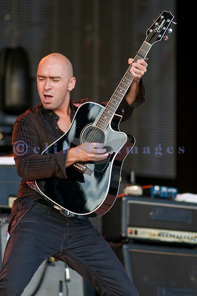 Frontman Ed Kowalcyzk of the band Live playing guitar and singing for the crowd at the Chippewa Valley Rock Festival.