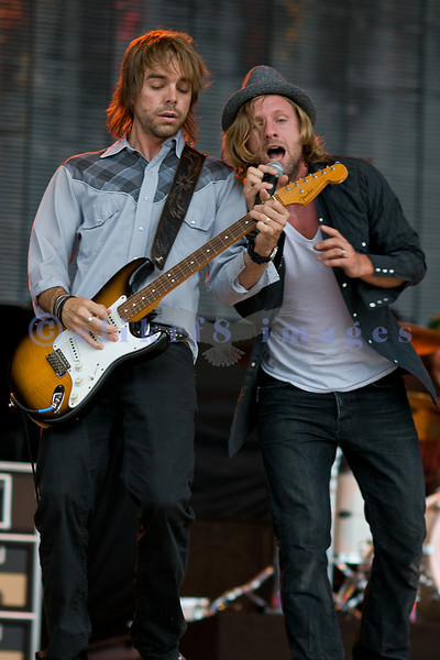 Torrential rains shortened the set by Switchfoot at the Chippewa Valley Rock Festival on Sunday. Jon Foreman on vocals and Drew Shirley, lead guitar in an energetic pose.