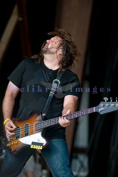 Brian Wheat on bass guitar for Tesla performs at the Chippewa Valley Rock Festival.