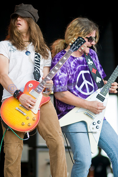 Frank Hannon and Dave Rude share guitarist duties on stage at the Chippewa Valley Rock Festival.