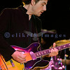 Jakob Dylan of the Wallflowers performing on stage out of the rain at the Chippewa Valley Rock Festival.