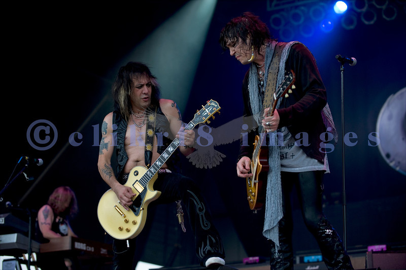 "Cinderella, whose hits include ""Nobody's Fool"" and ""Don't Know What You Got (Till It's Gone)"", put on an energetic show at the Chippewa Valley Rock Festival in Cadot, WI. Tom Keifer, vocals and guitar; Jeff LaBar, lead guitar; Eric Brittingham, bass guitar"