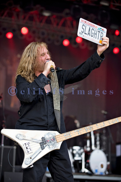 "Slaughter, glam rock band from the 80s, started the national act lineup Thursday at the Chippewa Valley Rock Festival in Cadot, WI. Jeff ""Blando"" Bland, guitar and Wisconsin plate"