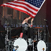 Slaughter, glam rock band from the 80s, started the national act lineup Thursday at the Chippewa Valley Rock Festival in Cadot, WI. Blas Elias, drums and American flag