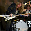 """Slaughter, glam rock band from the 80s, started the national act lineup Thursday at the Chippewa Valley Rock Festival in Cadot, WI. Jeff """"Blando"""" Bland, guitar; Blas Elias, drums"""
