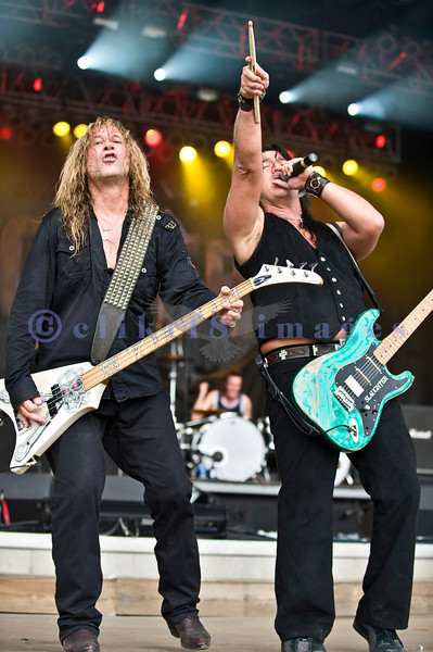 "Slaughter, glam rock band from the 80s, started the national act lineup Thursday at the Chippewa Valley Rock Festival in Cadot, WI. Jeff ""Blando"" Bland, guitar; Mark Slaughter, vocals; Blas Elias, drums"