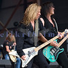 "Slaughter, glam rock band from the 80s, started the national act lineup Thursday at the Chippewa Valley Rock Festival in Cadot, WI. Jeff ""Blando"" Bland, guitar; Mark Slaughter, vocals; Dana Strum, bass"