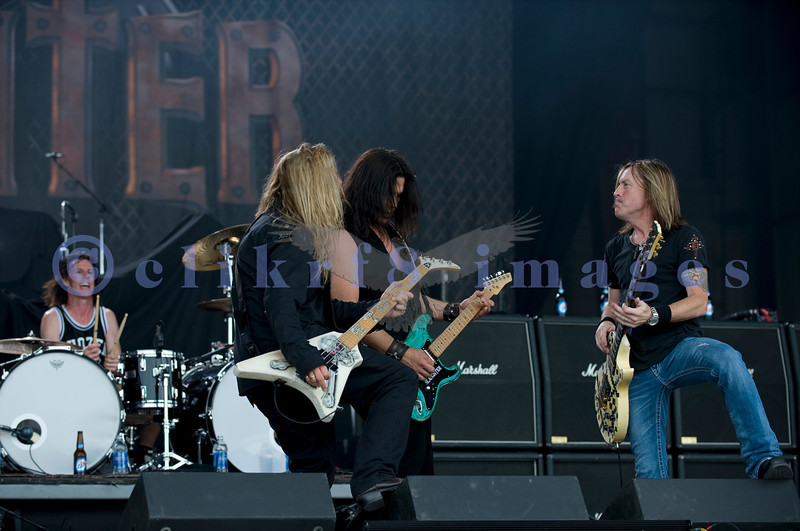 "Slaughter, glam rock band from the 80s, started the national act lineup Thursday at the Chippewa Valley Rock Festival in Cadot, WI. Jeff ""Blando"" Bland, guitar; Mark Slaughter, vocals; Dana Strum, bass guitar; Blas Elias, drums"