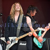 "Slaughter, glam rock band from the 80s, started the national act lineup Thursday at the Chippewa Valley Rock Festival in Cadot, WI. Jeff ""Blando"" Bland, guitar; Mark Slaughter, vocals"