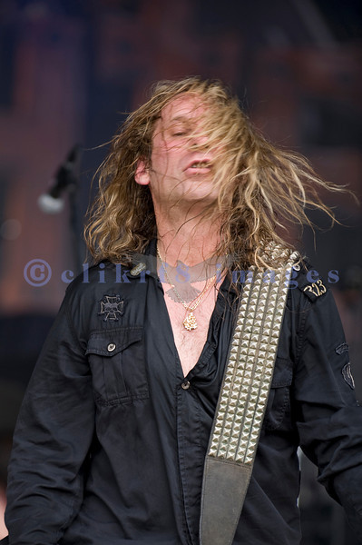 """Slaughter, glam rock band from the 80s, started the national act lineup Thursday at the Chippewa Valley Rock Festival in Cadot, WI. Jeff """"Blando"""" Bland, guitar"""