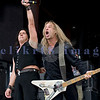 """Slaughter, glam rock band from the 80s, started the national act lineup Thursday at the Chippewa Valley Rock Festival in Cadot, WI. Jeff """"Blando"""" Bland, guitar; Mark Slaughter, vocals"""