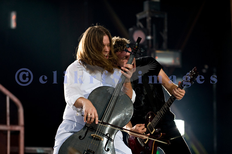 Back for a second year in a row, Christian rock band Skillet, was again a crowd favorite with their stage show of moving pedestals, pyros, and talented musicians at the Chippewa Valley Rock Festival in Cadot, WI. Tate Olsen, cello; Seth Morrison, lead guitar