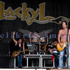 Chainsaw wielding Jackyl frontman Jesse James Dupree reprised his role from several years ago at the Chippewa Valley Rock Festival in Cadot, WI. Jeff Worley, lead guitar; Chris Worley, drums; Jesse James Dupree, vocals