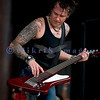 Chainsaw wielding Jackyl frontman Jesse James Dupree reprised his role from several years ago at the Chippewa Valley Rock Festival in Cadot, WI. Roman Glick, bass guitar