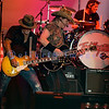 """Last minute replacement for Sunday's headliners Heart and Def Leppard, the Ted Nugent Band with its array of guitars as a backdrop showed that old rockers still rock. Derek St. Holmes, guitar and vocals; """"Wild"""" Mick Brown, drums; Ted Nugent, guitar and vocals"""