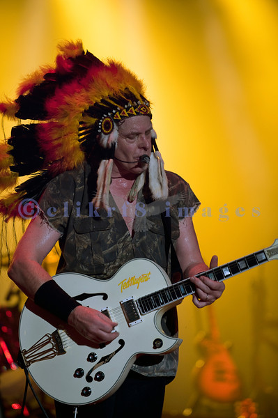 Last minute replacement for Sunday's headliners Heart and Def Leppard, the Ted Nugent Band with its array of guitars as a backdrop showed that old rockers still rock. Ted Nugent, guitar and vocals