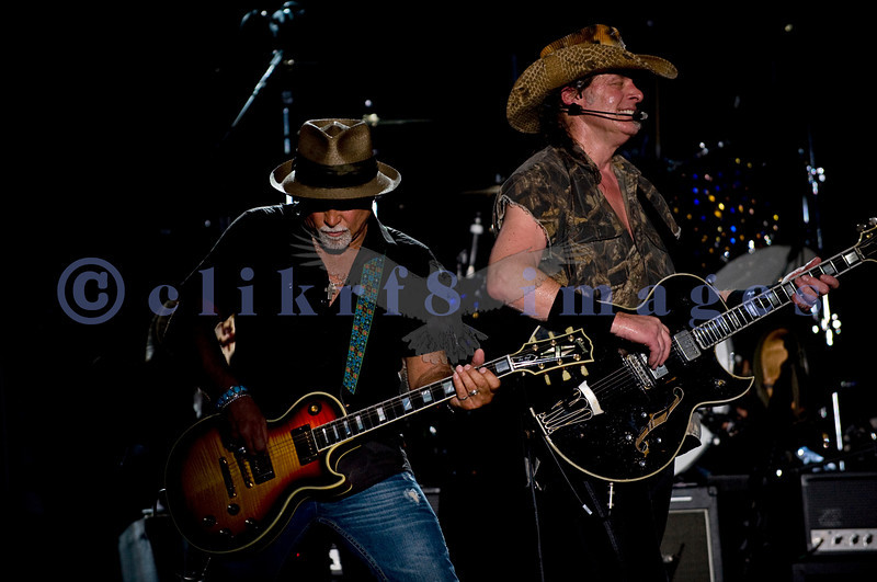 Last minute replacement for Sunday's headliners Heart and Def Leppard, the Ted Nugent Band with its array of guitars as a backdrop showed that old rockers still rock. Derek St. Holmes, guitar and vocals; Ted Nugent, guitar and vocals