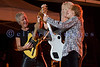 Kevin Cronin, frontman, Bruce Hall, bassist, and Dave Amato, lead guitarist for REO Speedwagon, perform together on stage at the Northwest Washington Fair in Lynden August 2007.