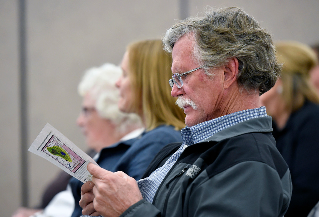 . Rob Bodine, of Broomfield, looks over a pamphlet during a Rocky Flats sharing session on Wednesday  at the Broomfield Community Center. Bodine is undecided on the Rocky Flats Refuge issue. The session was held by the U.S. Fish and Wildlife Service and was about updated plans for opening the Rocky Flats Wildlife Refuge, now set for Spring 2018. For more photos of the Rocky Flats Refuge session go to www.dailycamera.com Jeremy Papasso/ Staff Photographer/ Feb. 22, 2017