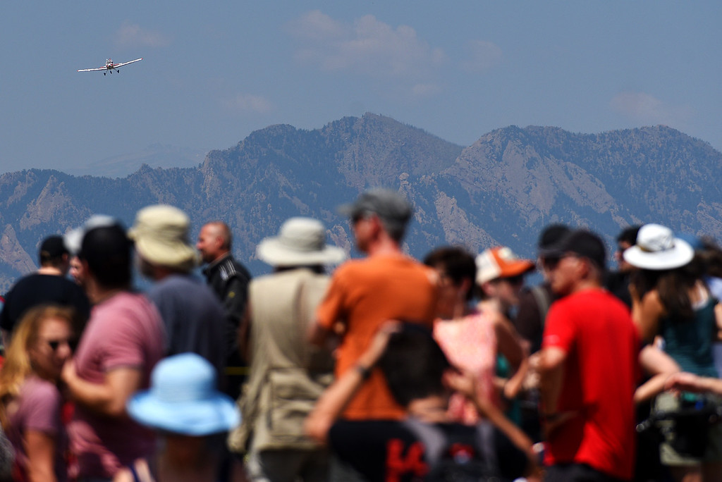 . Spectators watch the air show during the Broomfield Air and Car Show held at the Rocky Mountain Metropolitan Airport on Saturday.  Kira Vos / Special to the Camera / August 4, 2018