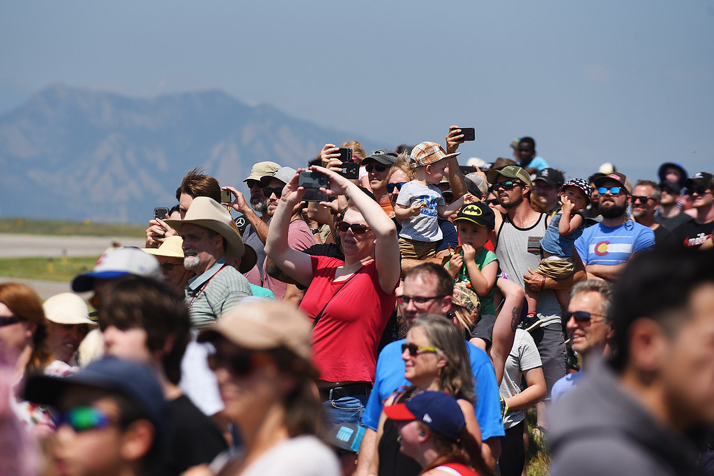 . Spectators watch for a fly by at the Broomfield Air and Car Show held at the Rocky Mountain Metropolitan Airport on Saturday.  Kira Vos / Special to the Camera / August 4, 2018