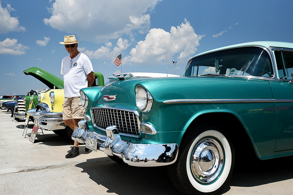 . Brian Hodgson admires a 1955 Belair Chevy at the Broomfield Air and Car Show held at the Rocky Mountain Metropolitan Airport on Saturday.  Kira Vos / Special to the Camera / August 4, 2018