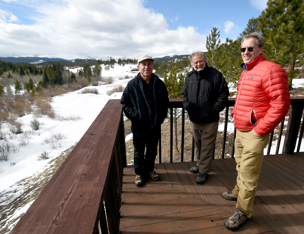 . Johann Robbins, left, David Loy, and Russ Hullet, enjoy the views from the deck of the main building.  Johann Robbins and associates are purchasing 180 acres of pristine land - and a structure or two - as a place for people to go unwind and connect in these  stressful times. Cliff Grassmick  Staff Photographer  February 9, 2017