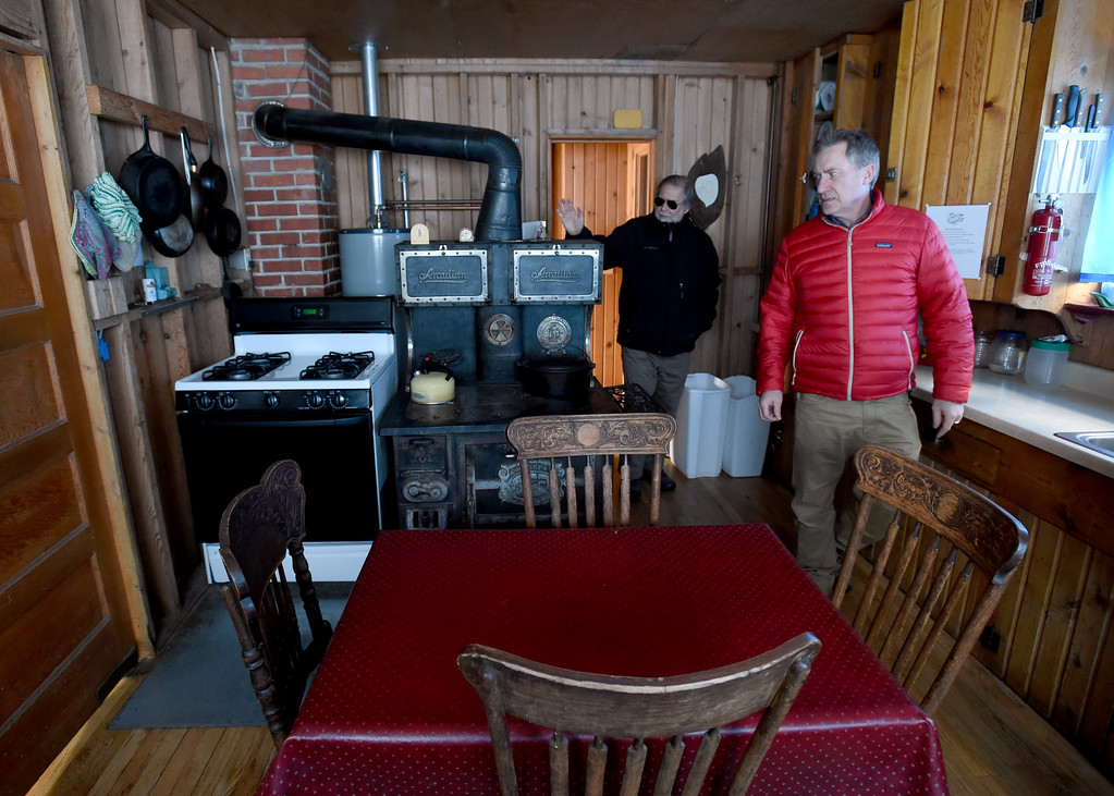 . David Loy, left, and David Hullet, tour the kitchen of the main building. Johann Robbins and associates are purchasing 180 acres of pristine land - and a structure or two - as a place for people to go unwind and connect in these  stressful times. Cliff Grassmick  Staff Photographer  February 9, 2017
