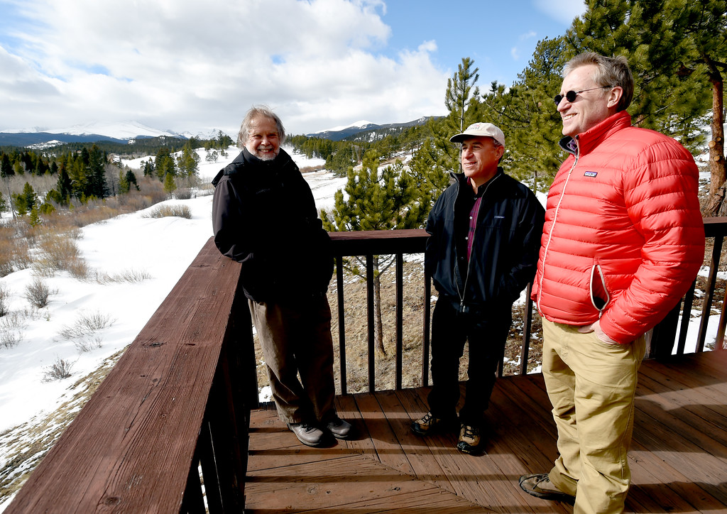 . David Loy, left, Johann Robbins , and Russ Hullet, enjoy the views from the deck of the main building. Johann Robbins and associates are purchasing 180 acres of pristine land - and a structure or two - as a place for people to go unwind and connect in these  stressful times. Cliff Grassmick  Staff Photographer  February 9, 2017
