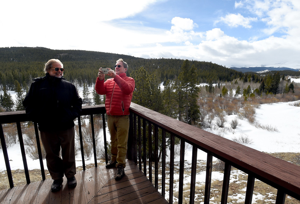 . David Loy, left, and Russ Hullet, on the deck of the main structure. Johann Robbins and associates are purchasing 180 acres of pristine land - and a structure or two - as a place for people to go unwind and connect in these  stressful times. Cliff Grassmick  Staff Photographer  February 9, 2017