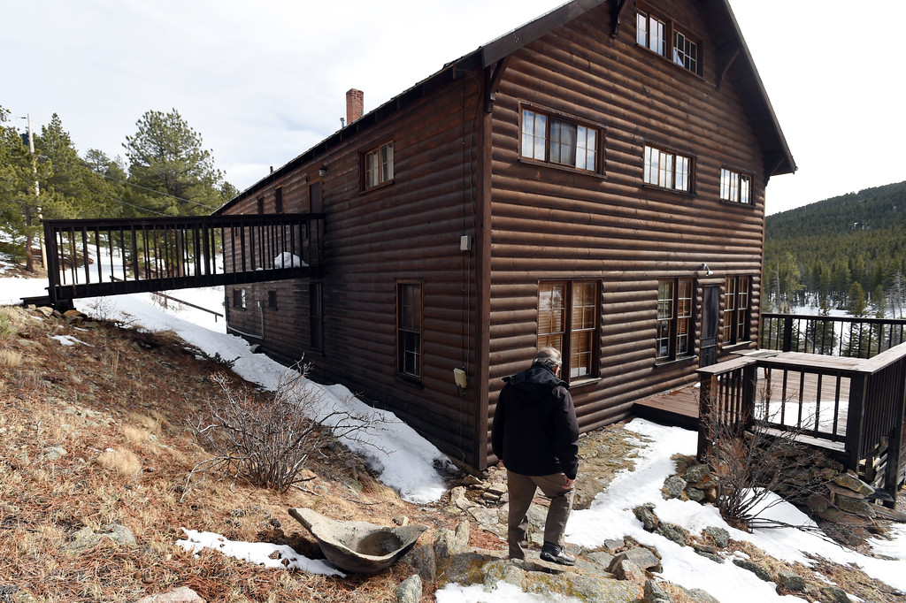 . David Loy walks down to the main structure during a tour on Thursday.  Johann Robbins and associates are purchasing 180 acres of pristine land - and a structure or two - as a place for people to go unwind and connect in these  stressful times. Cliff Grassmick  Staff Photographer  February 9, 2017