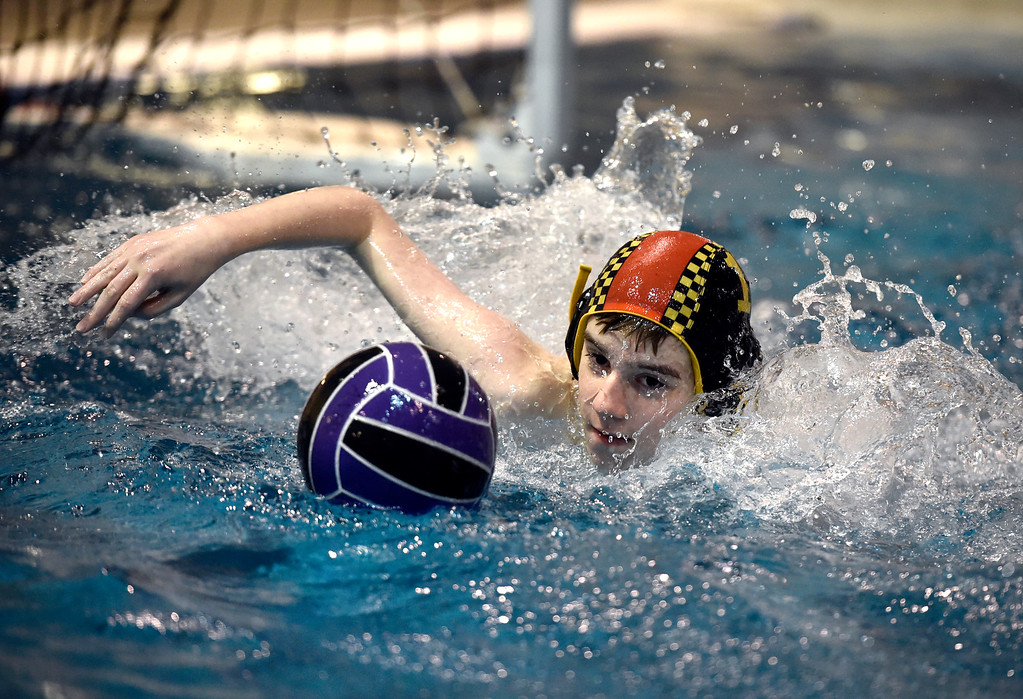 . THORTON, CO - MARCH 6, 2019: Rocky Mountain Neptunes water polo goalkeeper Noah Staab, 13, chases a failed goal attempt during a practice on Wednesday night at the Veterans Aquatic Memorial Center in Thornton. For more photos of the practice go to dailycamera.com (Photo by Jeremy Papasso/Staff Photographer)