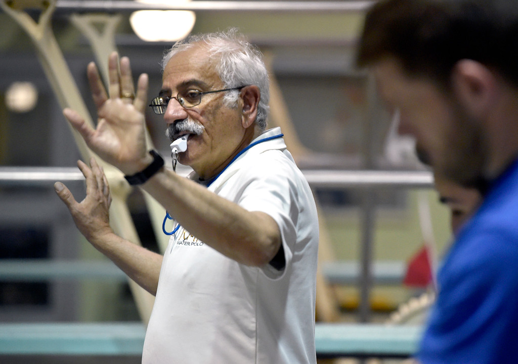 . THORTON, CO - MARCH 6, 2019: Rocky Mountain Neptunes Founder and Head Coach Manucher Ghaffari blows the whistle signaling the start of a water polo drill during a practice on Wednesday night at the Veterans Aquatic Memorial Centerr in Thornton. For more photos of the practice go to dailycamera.com (Photo by Jeremy Papasso/Staff Photographer)