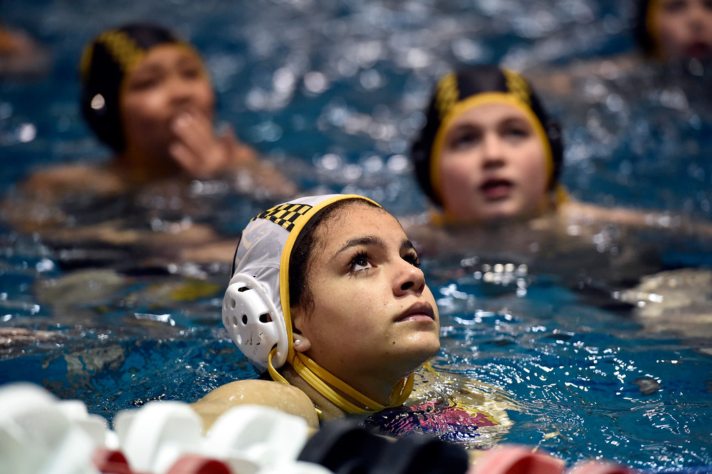 . THORTON, CO - MARCH 6, 2019: Rocky Mountain Neptunes water polo player Auden Ketellapper, 12, listens as Head Coach Manucher Ghaffari speaks during a practice on Wednesday night at the Veterans Aquatic Memorial Center in Thornton. For more photos of the practice go to dailycamera.com (Photo by Jeremy Papasso/Staff Photographer)
