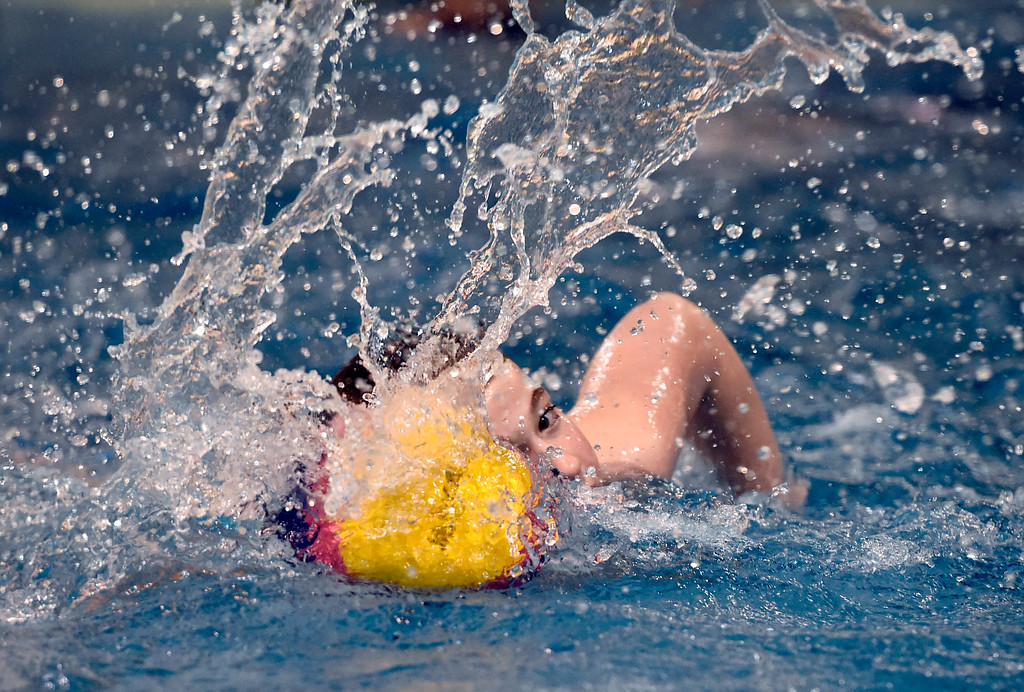 . THORTON, CO - MARCH 6, 2019: Rocky Mountain Neptunes water polo player Stephen Codevilla, 12, moves the ball during a practice on Wednesday night at the Veterans Aquatic Memorial Center in Thornton. For more photos of the practice go to dailycamera.com (Photo by Jeremy Papasso/Staff Photographer)