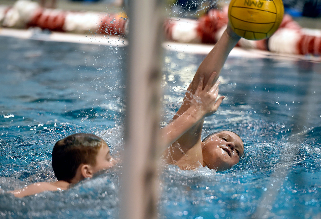 . THORTON, CO - MARCH 6, 2019: Rocky Mountain Neptunes water polo player William Perrotta, 11, attempts a shot on goal during a practice on Wednesday night at the Veterans Aquatic Memorial Center in Thornton. For more photos of the practice go to dailycamera.com (Photo by Jeremy Papasso/Staff Photographer)