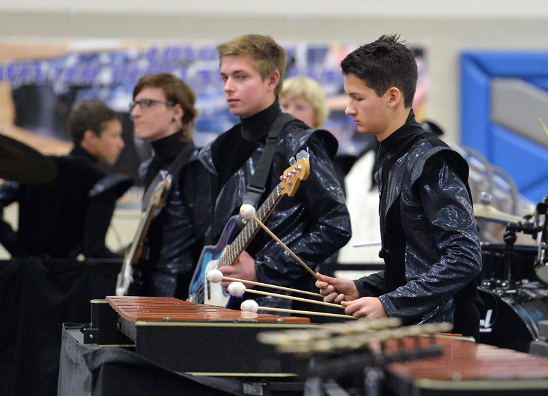 "Samuel Narvaez, right, plays the xylophone with the Longmont High Percussion team while they perform their routine during the Rocky Mountain Percussion Association's contest #4 at Longmont High School on Saturday.<br /> <br /> More photos:  <a href=""http://www.BoCoPreps.com"">http://www.BoCoPreps.com</a><br /> David R. Jennings/Staff Photographer<br /> March 26, 2016"