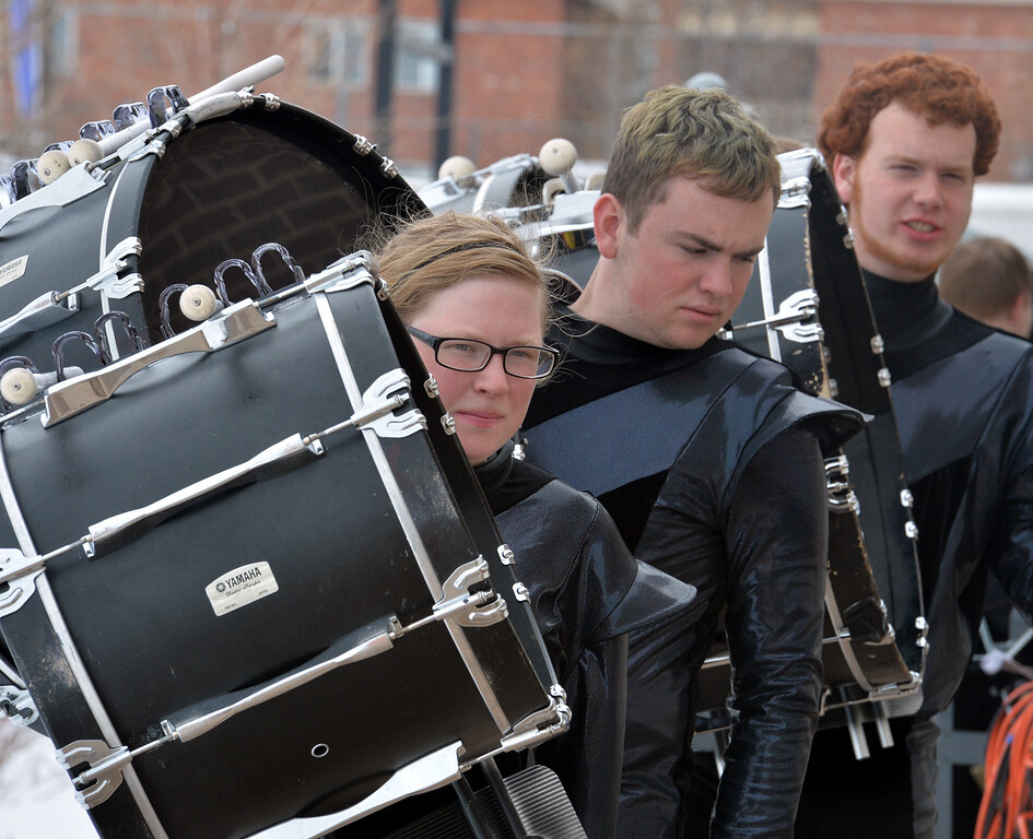 "Nicole Phipps leads the bass drums section to the staging area before the Longmont High Percussion team performs their routine during the Rocky Mountain Percussion Association's contest #4 at Longmont High School on Saturday.<br /> <br /> More photos:  <a href=""http://www.BoCoPreps.com"">http://www.BoCoPreps.com</a><br /> David R. Jennings/Staff Photographer<br /> March 26, 2016"